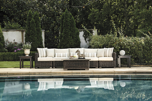 outdoor sofa and aluminum end tables in resin wicker traditional-patio