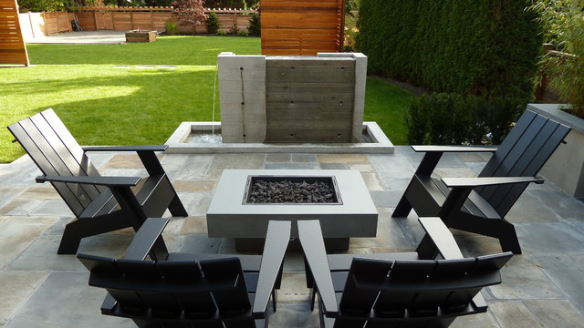 Inspiration for a mid-sized craftsman backyard stone patio remodel in Vancouver with a fire pit and a roof extension