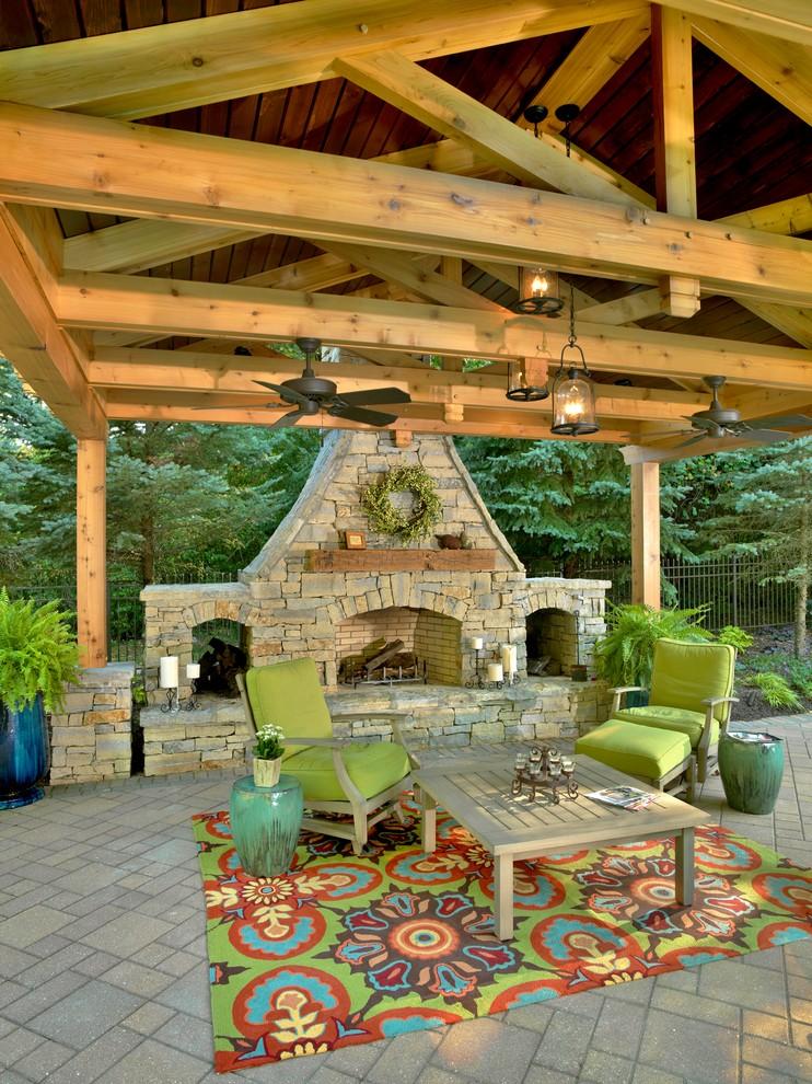 Elegant patio photo in Cincinnati with a fire pit and a pergola