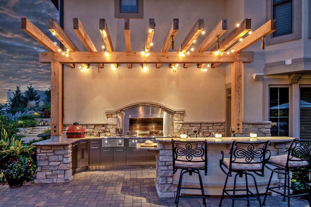 Elegant patio kitchen photo in Bridgeport with a pergola