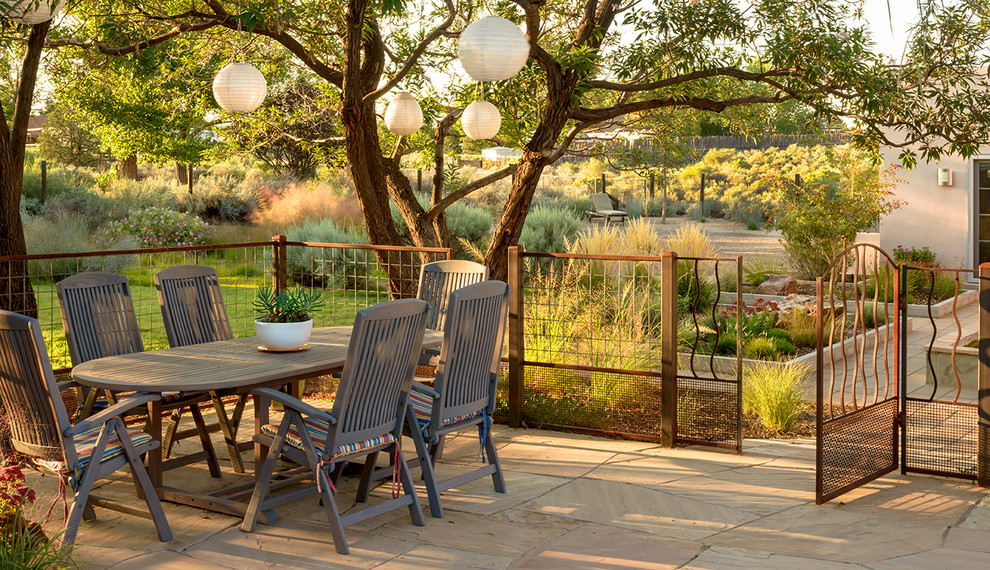 Example of an eclectic patio design in Albuquerque with no cover