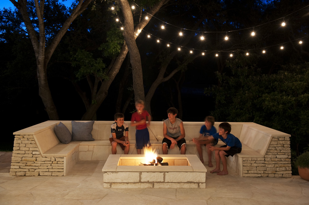 Patio - contemporary patio idea in Austin with a fire pit