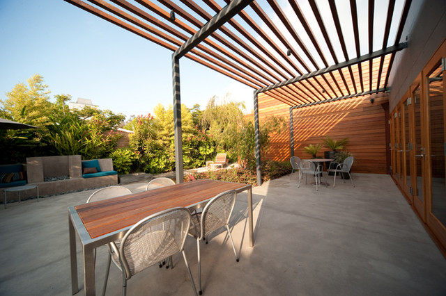 Overhead Wood And Steel Trellis Create Filtered Shade
