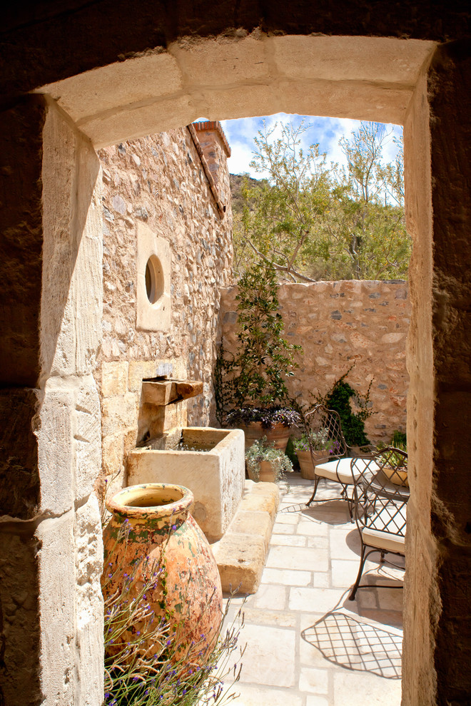 Inspiration for a mediterranean courtyard patio fountain remodel in Phoenix