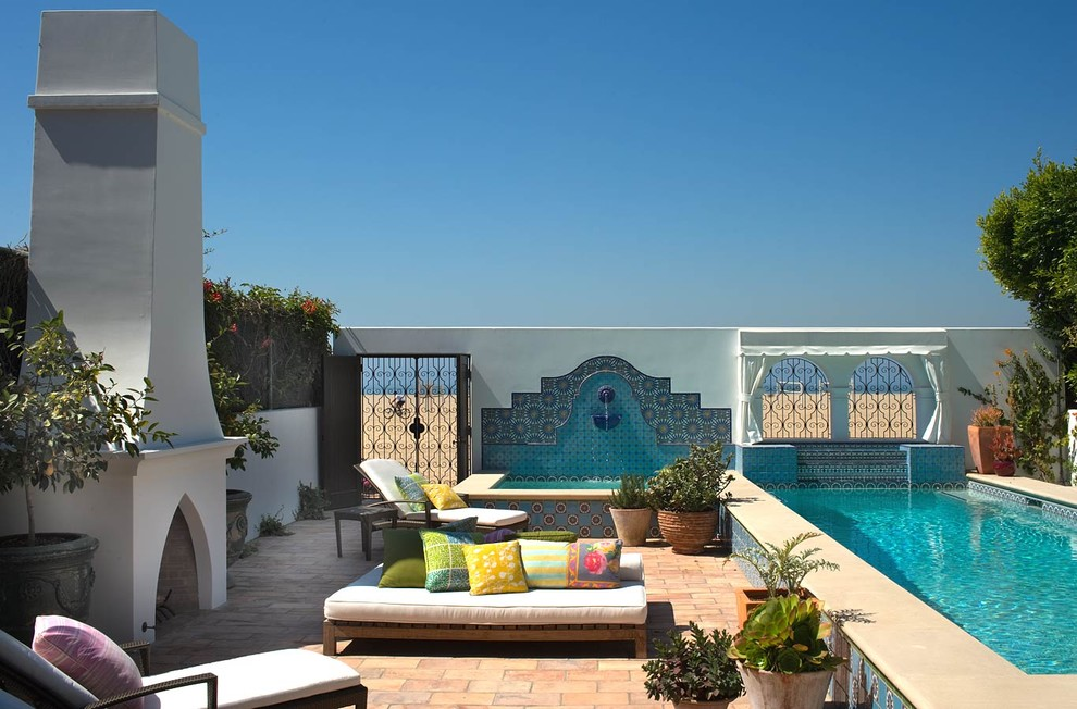 Inspiration for a mediterranean patio remodel in Los Angeles with a fire pit