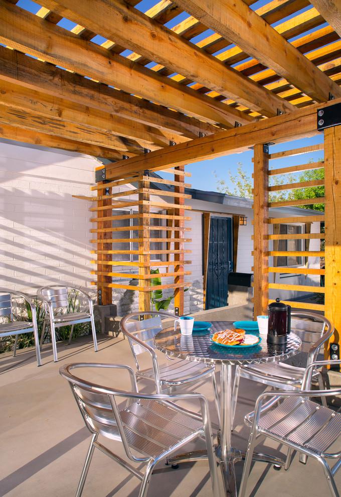 Patio - modern patio idea in Phoenix with a pergola