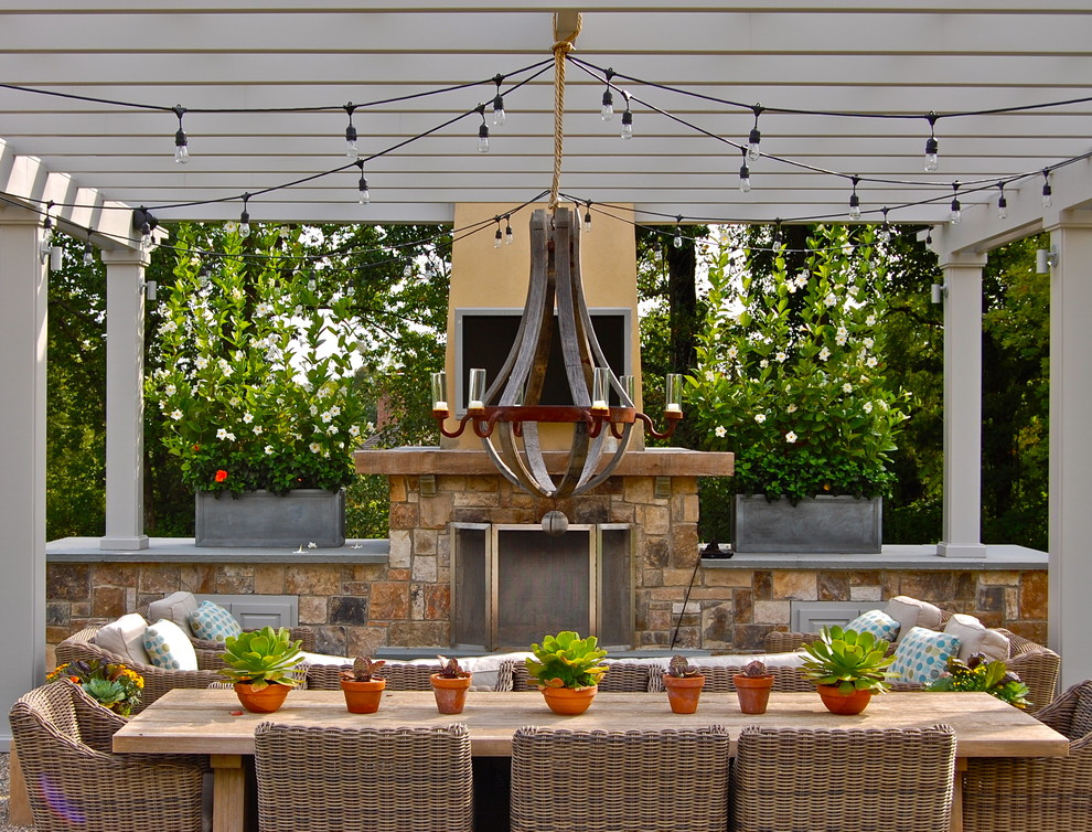 Example of a classic patio design in New York with a pergola