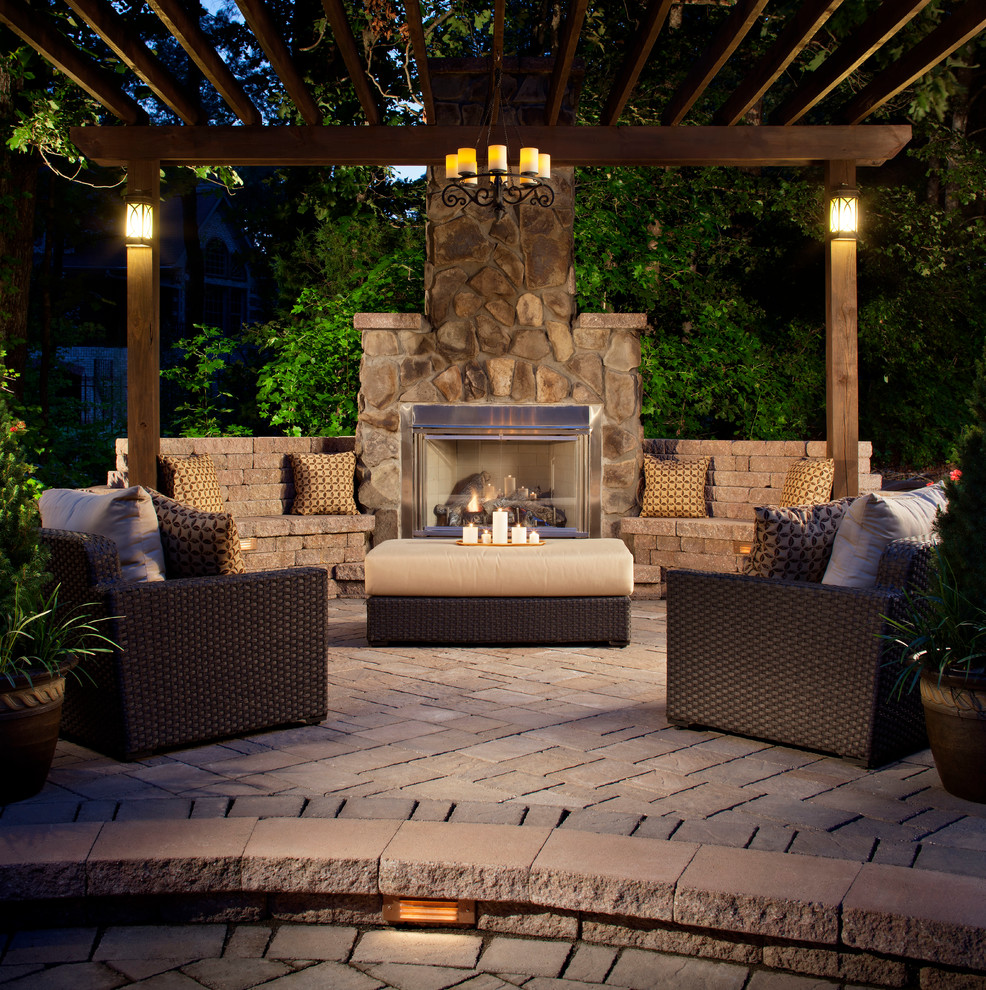 Patio - traditional patio idea in Charlotte with a fire pit and a gazebo