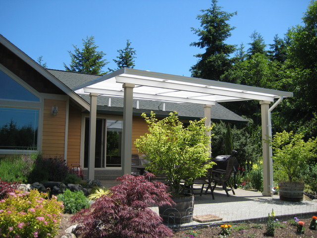 Patio   Mid Sized Farmhouse Backyard Concrete Patio Idea In Seattle With An  Awning