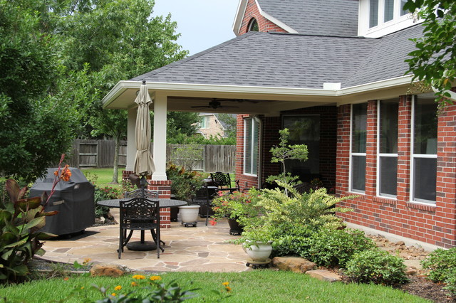Patio cover with decorative concrete in cypress tx for Tradition outdoor living