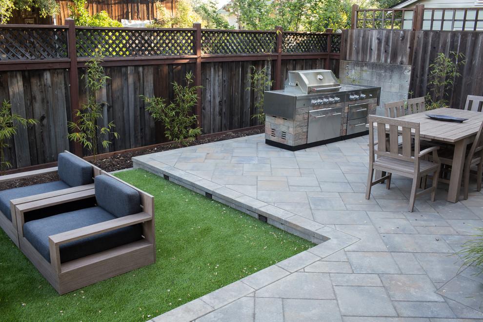 Small transitional backyard concrete paver patio kitchen photo in San Francisco