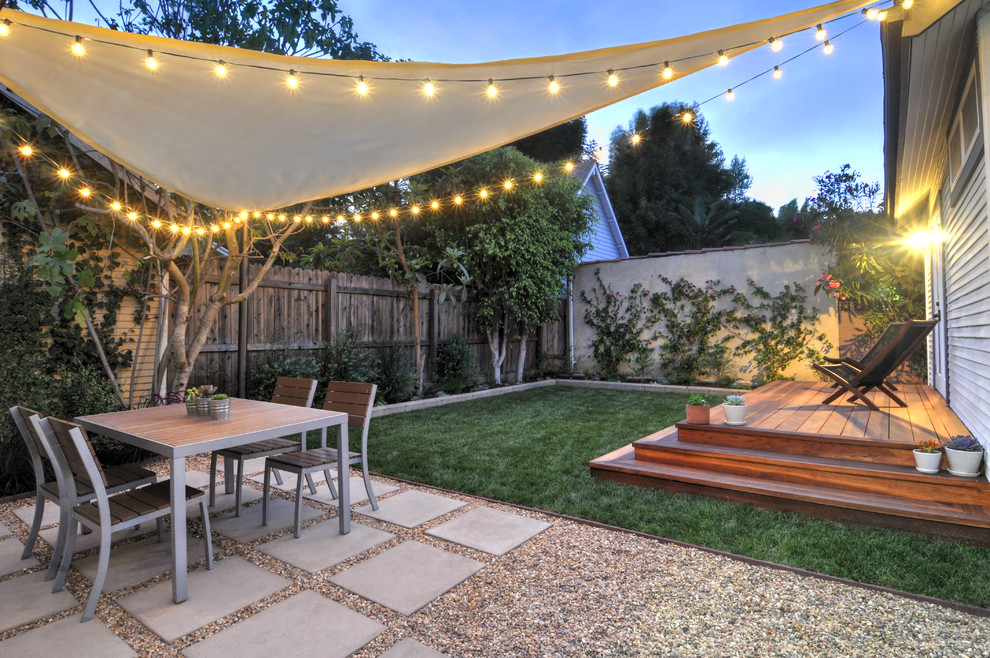 Example of a trendy backyard concrete paver patio design in Los Angeles