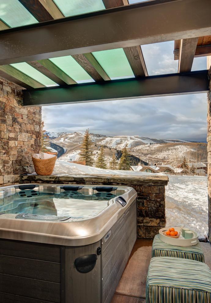 Mountain style patio photo in Salt Lake City with a pergola