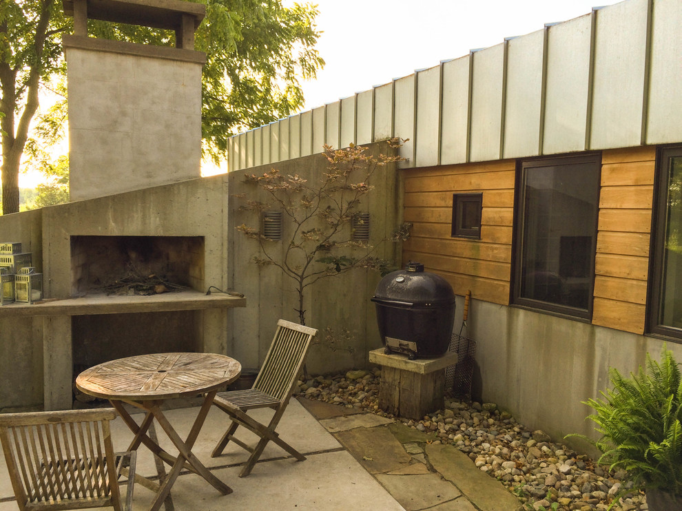 Patio with Concrete Fireplace - Modern - Patio - Other ... on Modern Concrete Backyard id=90617
