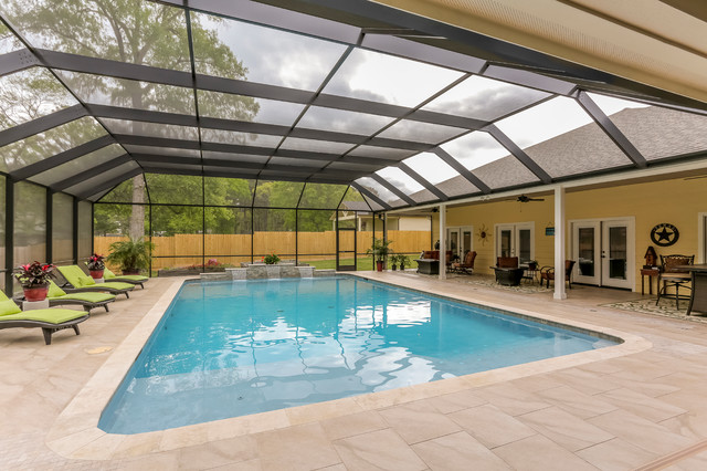 Patio With Fireplace With Screened Pool Enclosure