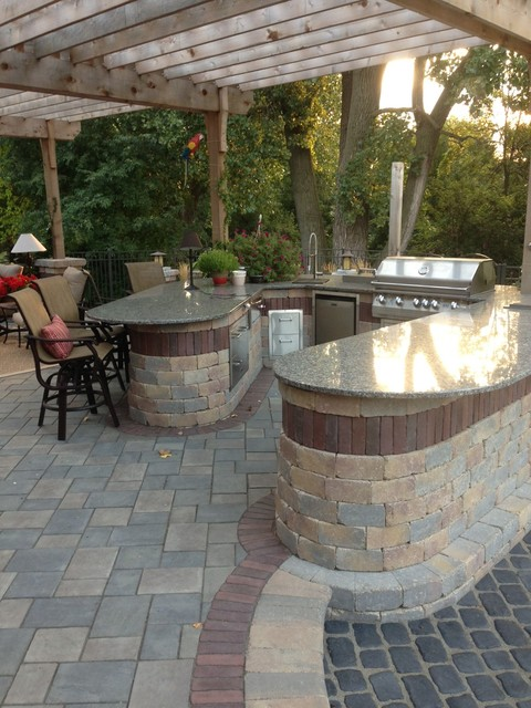 paver patio with fireplace and bar