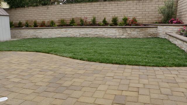 Paver Patio With Stone Veneer Planter