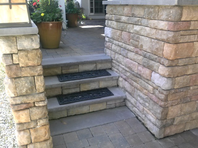 Paver Walkways And Pool Deck With Stone Veneer Retaining Wall