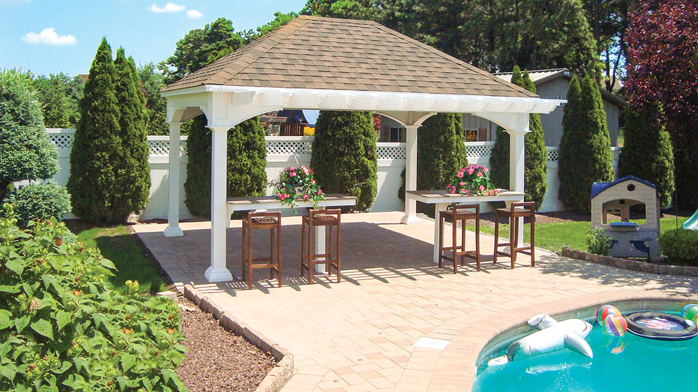 Inspiration for a mid-sized timeless backyard brick patio remodel in Philadelphia with a gazebo