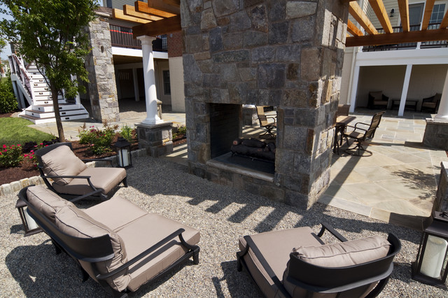 Pea gravel patio and outdoor fireplace traditional-patio