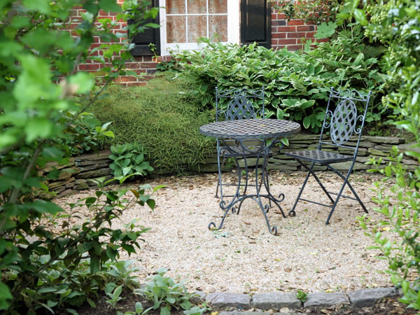 Garden Furniture On Gravel pea gravel patio with stacked stone wall - contemporary - patio