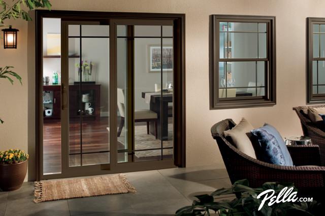 Patio - contemporary patio idea in Cedar Rapids - Pella® 350 Series Sliding Patio Door Accents Prairie Style