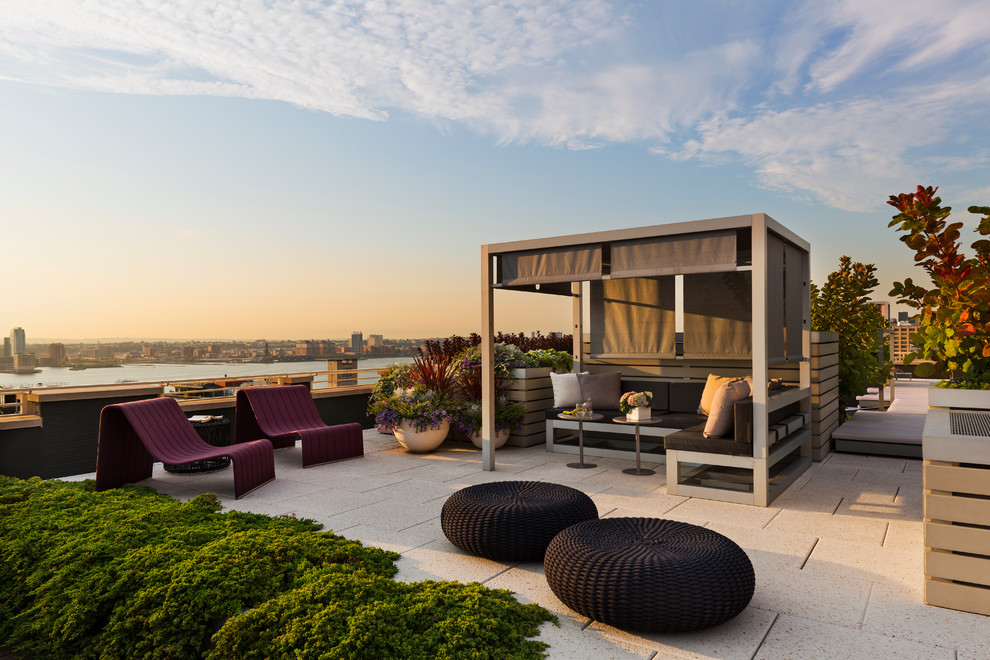 Example of a trendy patio design in New York with a gazebo
