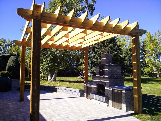 Design Ideas For A Mid Sized Traditional Backyard Patio In Calgary With Pergola And