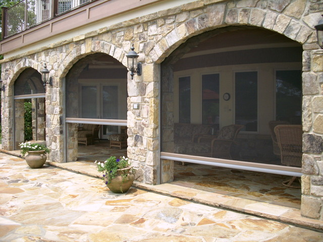 Phantom retractable screens in stone archway for Automatic retractable screens