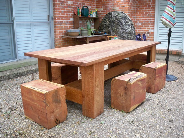 Picnic table with cedar log stools contemporary patio for Flat pack garden decking