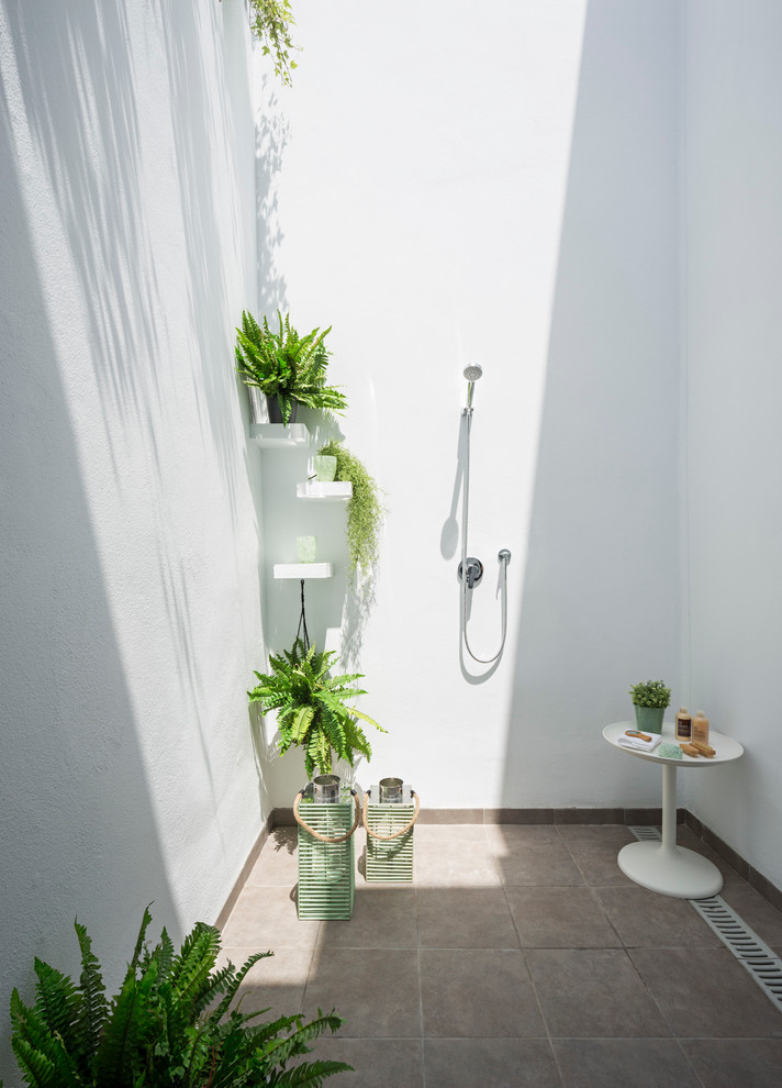 Outdoor patio shower - mid-sized coastal tile outdoor patio shower idea in Malaga with no cover