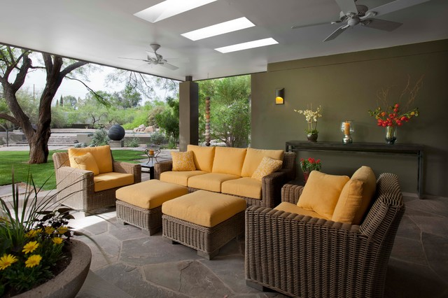 Trendy stone patio photo in Phoenix with a roof extension