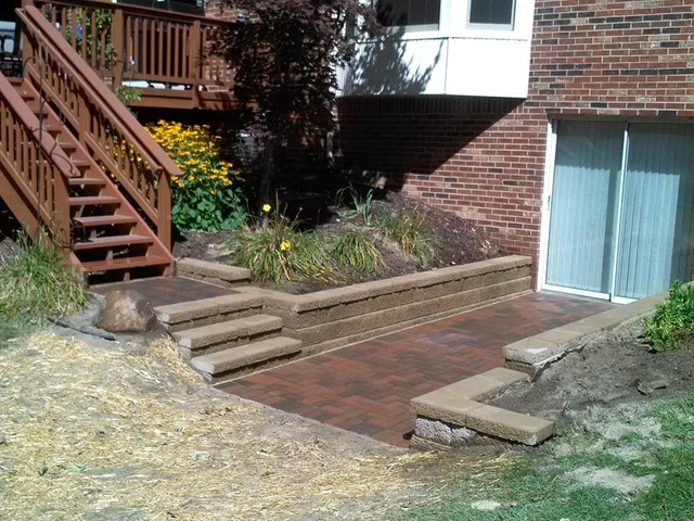 Plymouth walk out basement patio with retaining walls for Walkout basement retaining walls