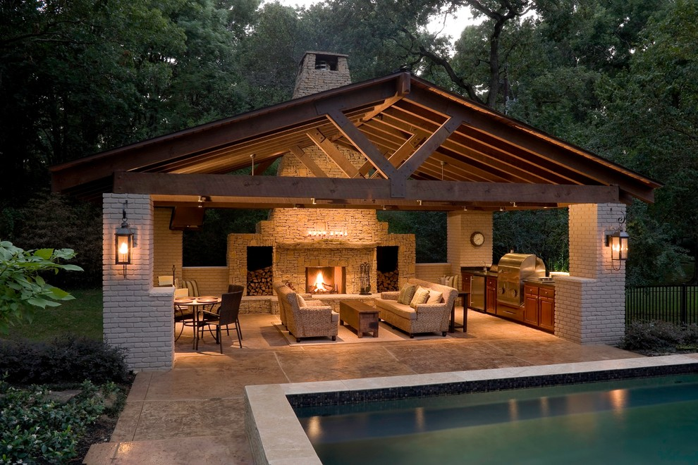 Patio - large contemporary backyard stamped concrete patio idea in Houston with a fire pit and a gazebo