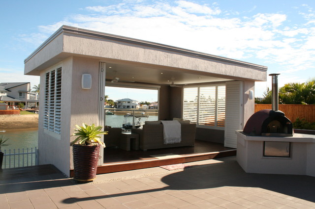 Pool House with Aluminum Shutters contemporary-patio