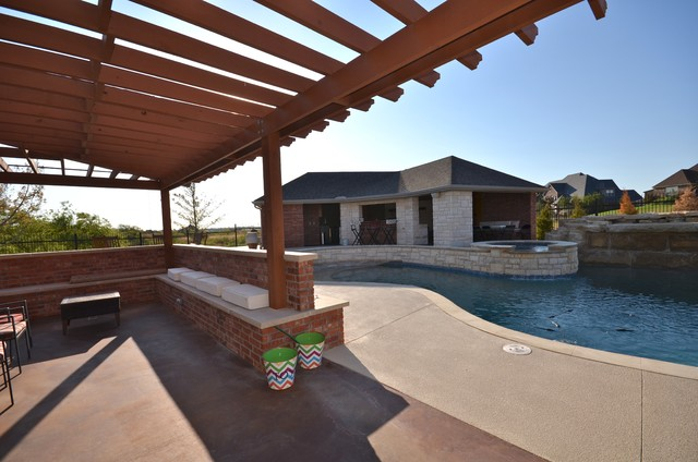 Inspiration for a mid-sized craftsman backyard concrete patio kitchen remodel in Austin with a pergola