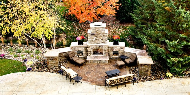 Poolside fireplace from balcony - Traditional - Patio ...