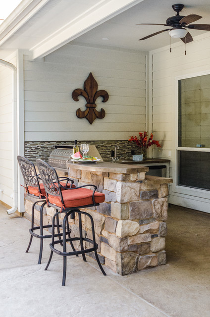 Poolside Outdoor Kitchen traditional-courtyard