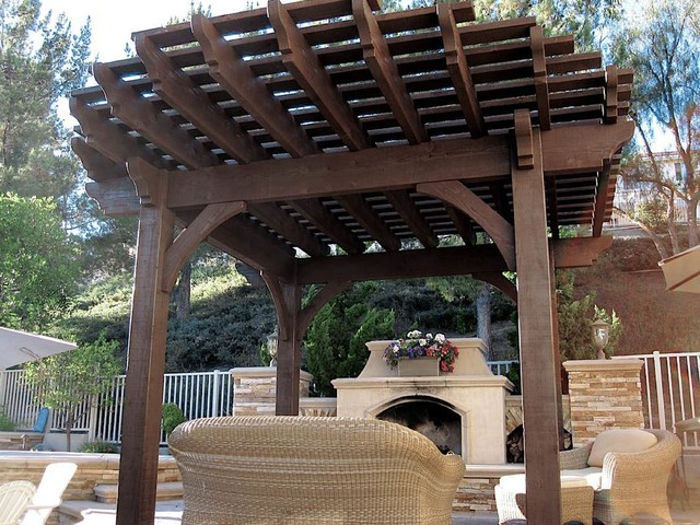 poolside timber frame pergola with outdoor fireplace patio
