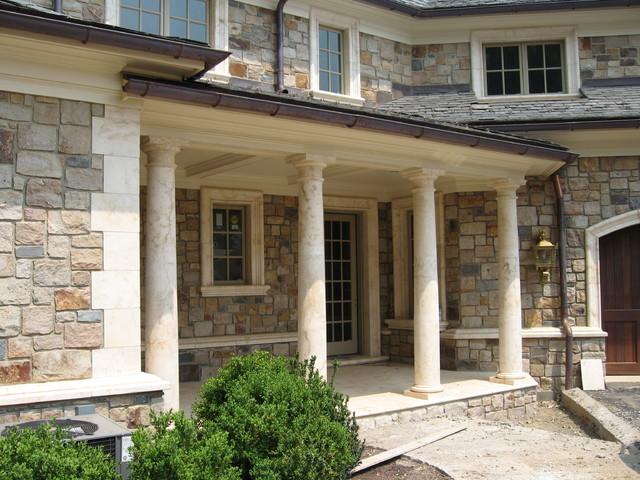 Porch stone columns mediterranean patio newark by for International home decor llc