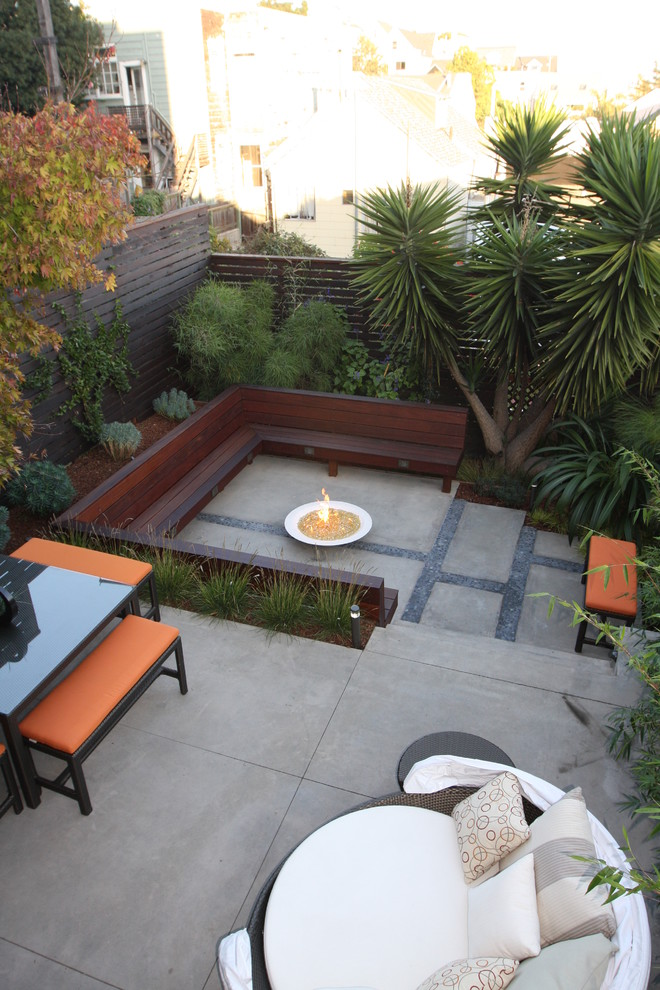 Patio - modern concrete patio idea in San Francisco with a fire pit and no cover