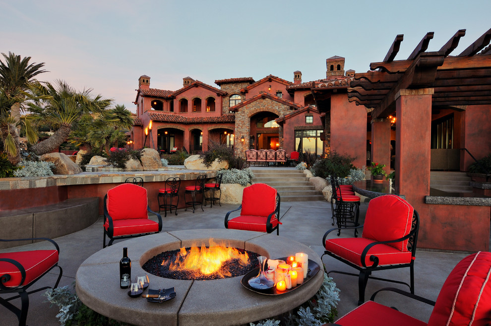 Example of a tuscan patio kitchen design in San Diego