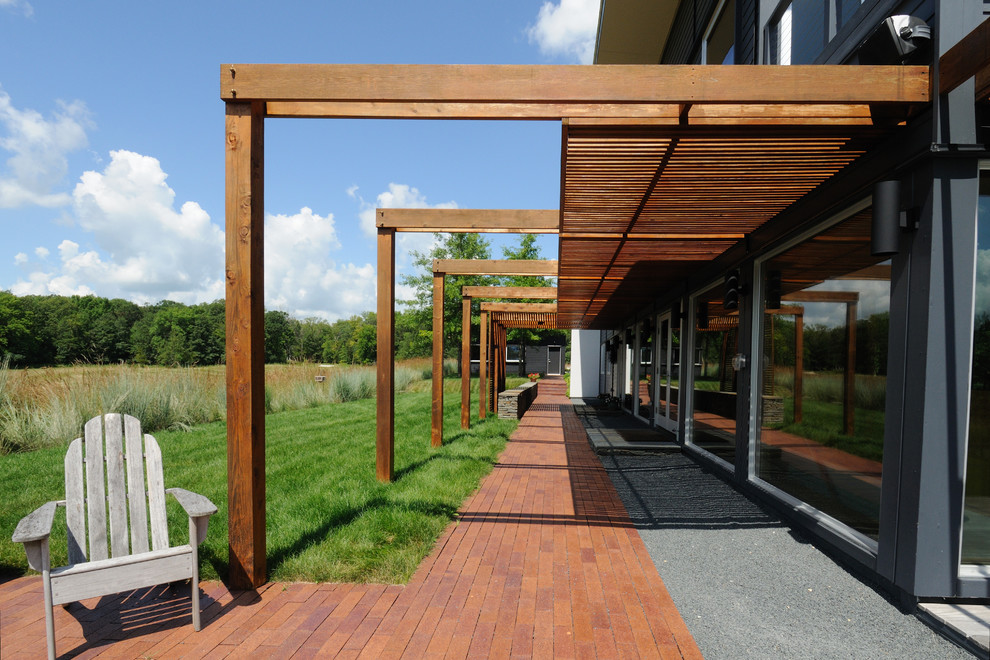Inspiration for a contemporary patio remodel in Minneapolis with a pergola