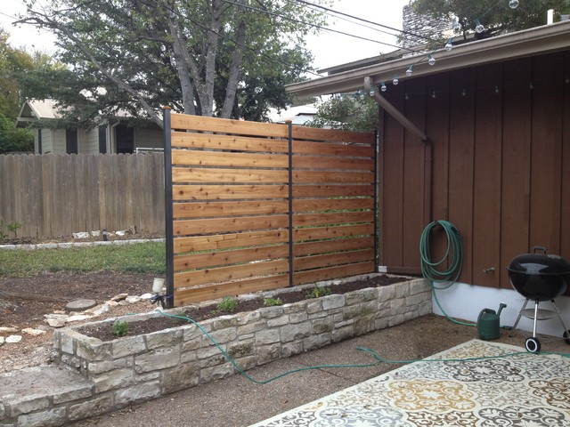 Privacy fence industrial patio austin by sierra prana for Garden privacy wall ideas