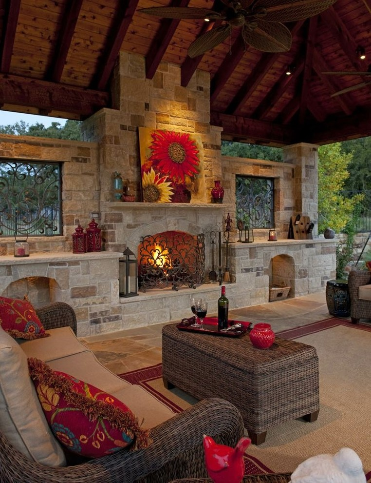 Inspiration for a large timeless backyard stone patio remodel in Dallas with a fire pit and a gazebo