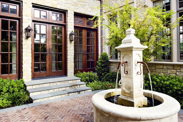 Private residence english tudor for Traditional outdoor design
