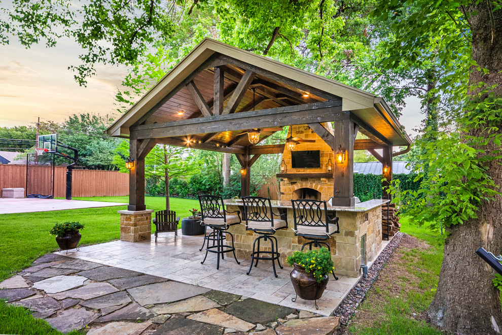 Example of a mid-sized mountain style backyard tile patio design in Houston with a gazebo