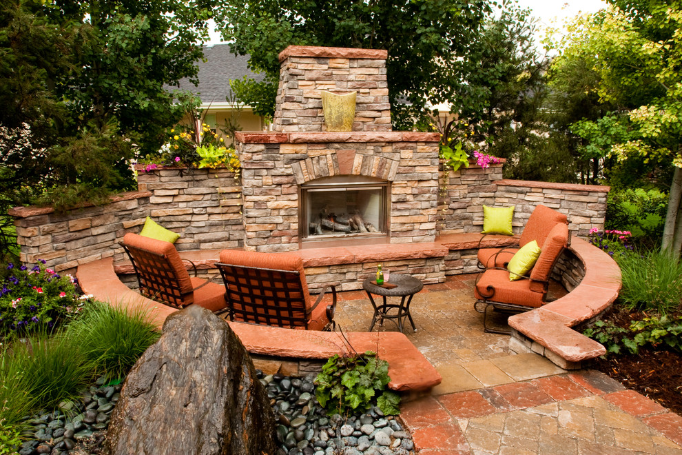 Large elegant backyard concrete paver patio photo in Denver with a fire pit and no cover