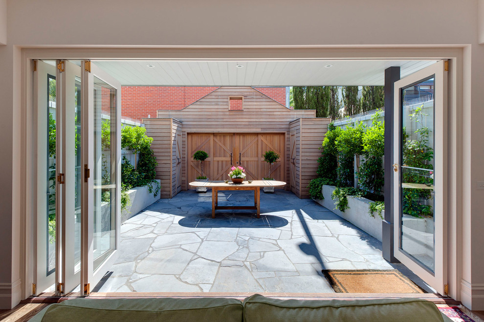 Inspiration for a small rustic courtyard patio remodel in Melbourne