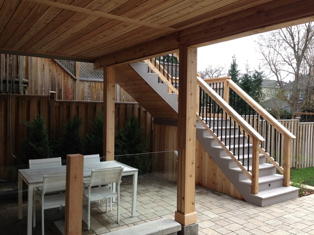 Pvc Deck With Glass Railings And Walkout Basement